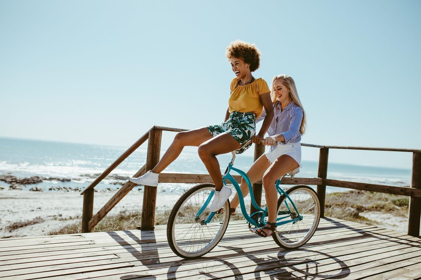 Girls having a great fun on bike