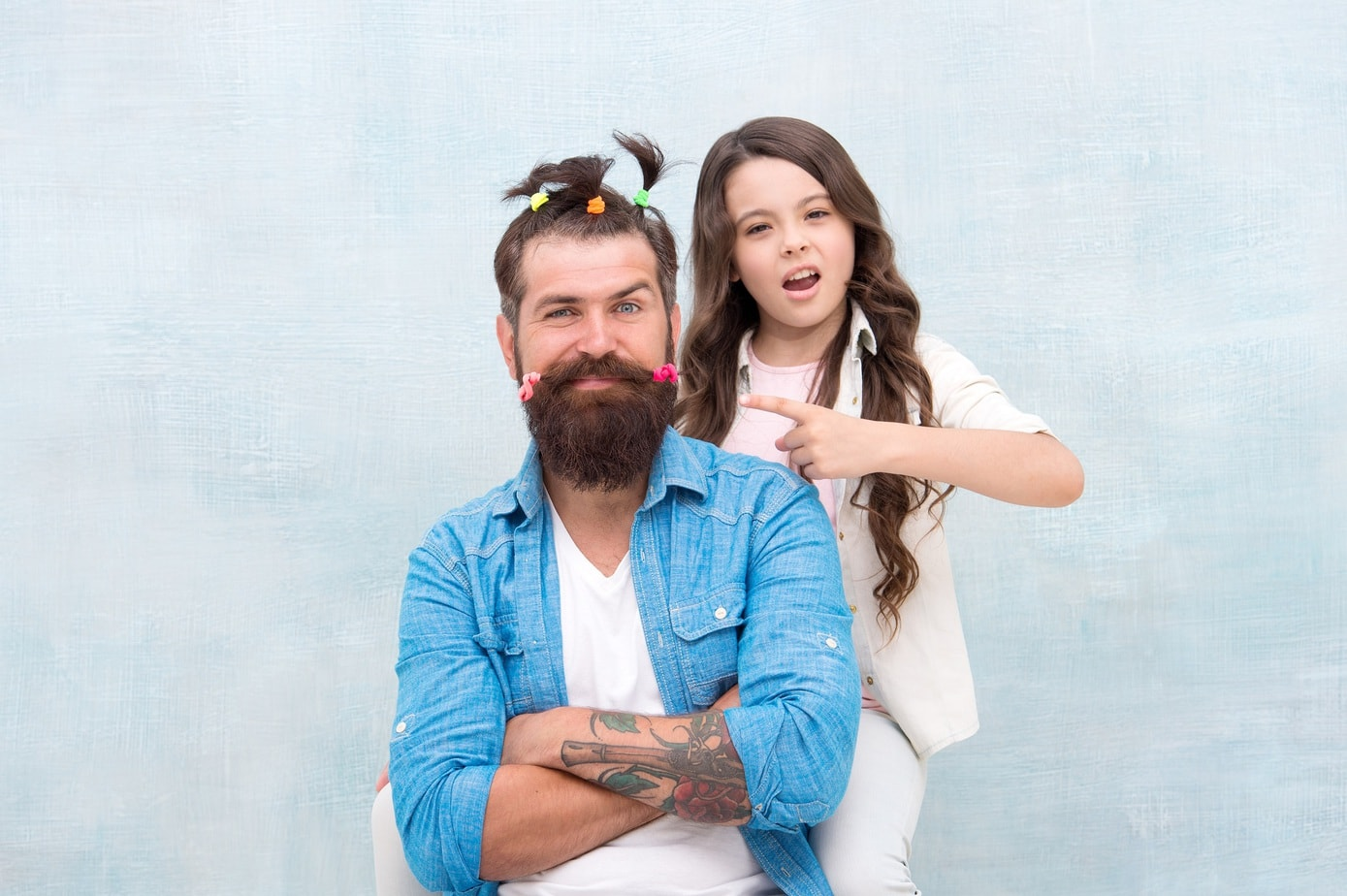 Making me happy. Daughter creating fathers hair. Handsome father with little girl. Happy father and daughter. little girl love her daddy. happy fathers day. family. Fathers day with daughter at home